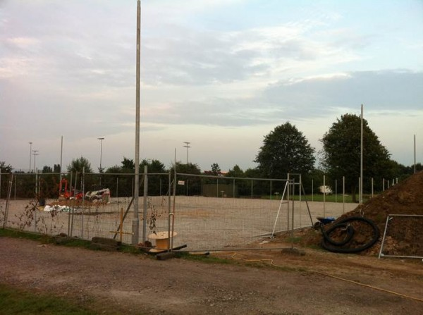 The posts for the floodlights are up.